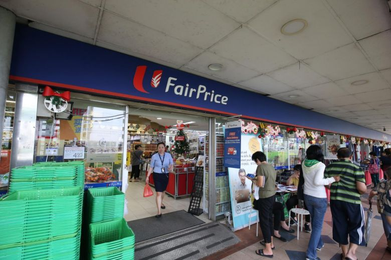 Entrance of FairPrice Supermarket with customers