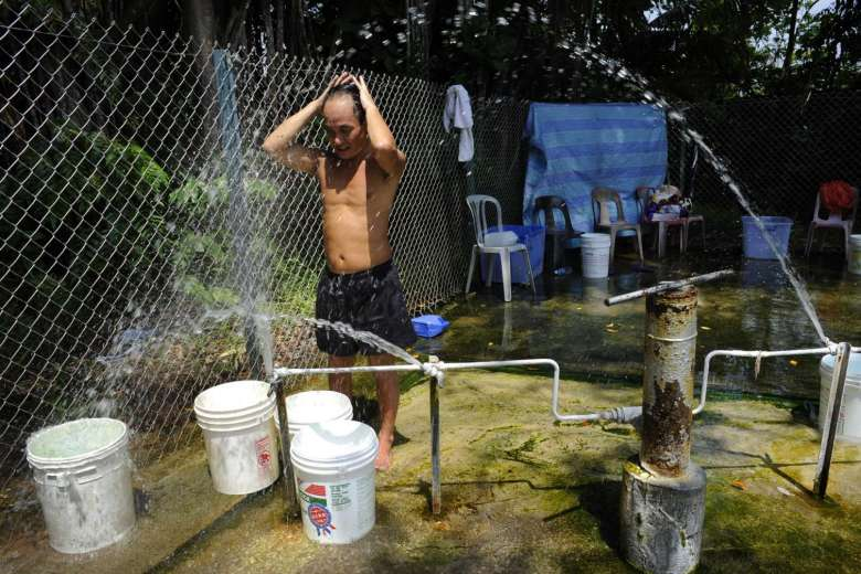 Man Relaxing At Sembawang Hot Spring