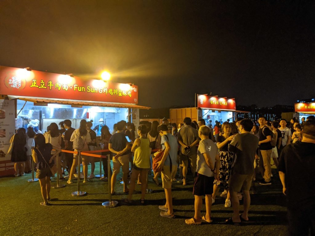 People Queuing Up For Fun Sun G Fried Chicken