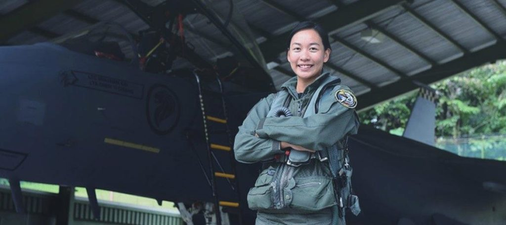 Female Pilot Standing In Front Of F-16