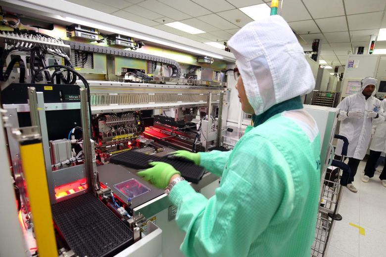 Worker Working in a Semiconductor Factory
